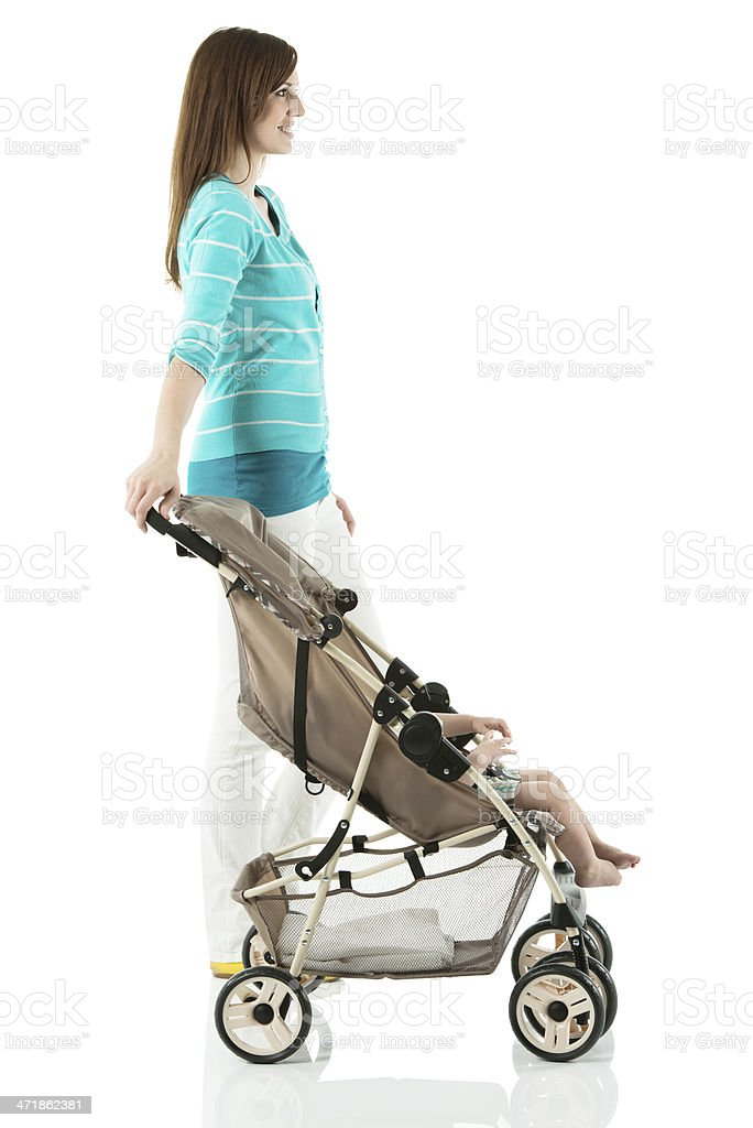 Young mother with baby in stroller royalty-free stock photo