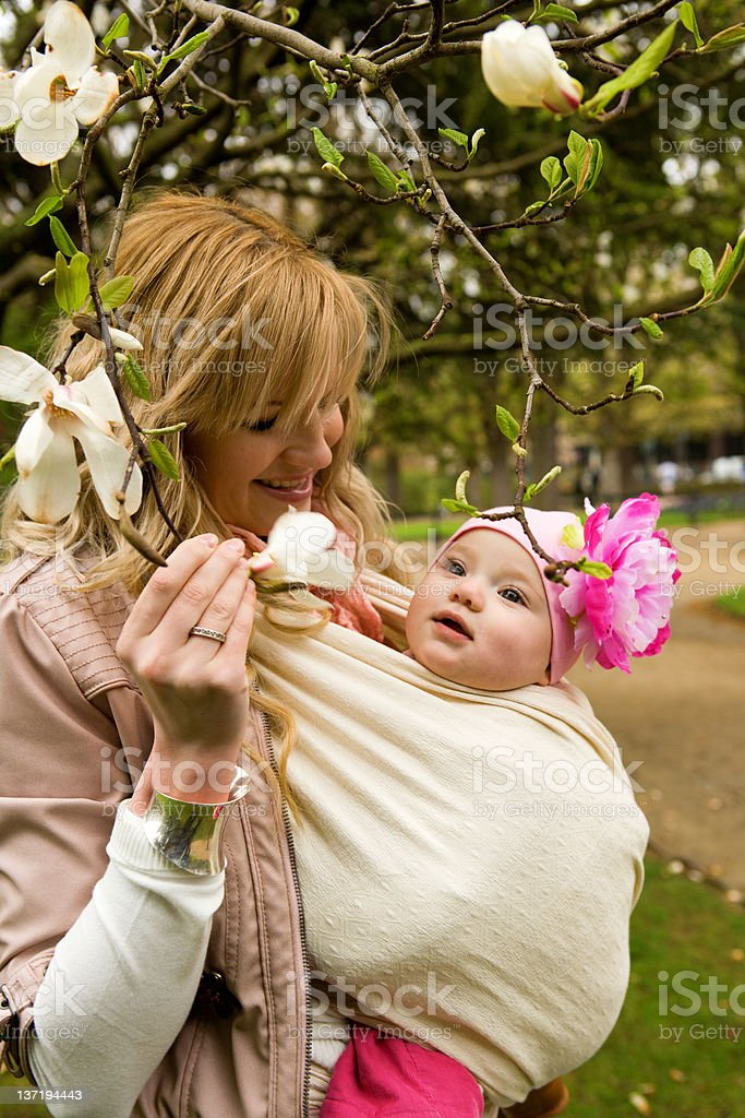 Young mother with her baby daughter in a garden royalty-free stock photo