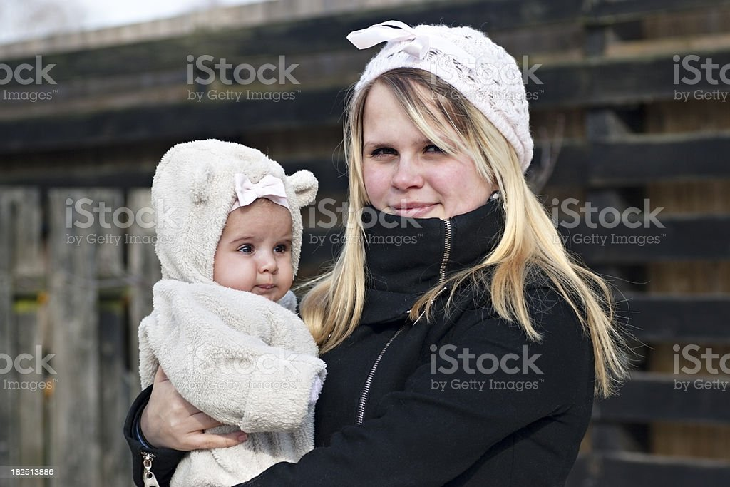 Young mother with her baby standing outside royalty-free stock photo
