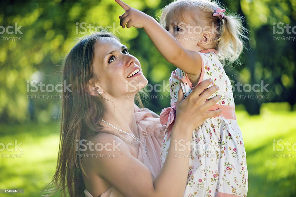 Young mother with her daughter in park royalty-free stock photo