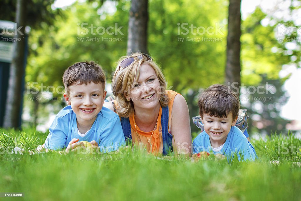 Young mother with kids and apples royalty-free stock photo
