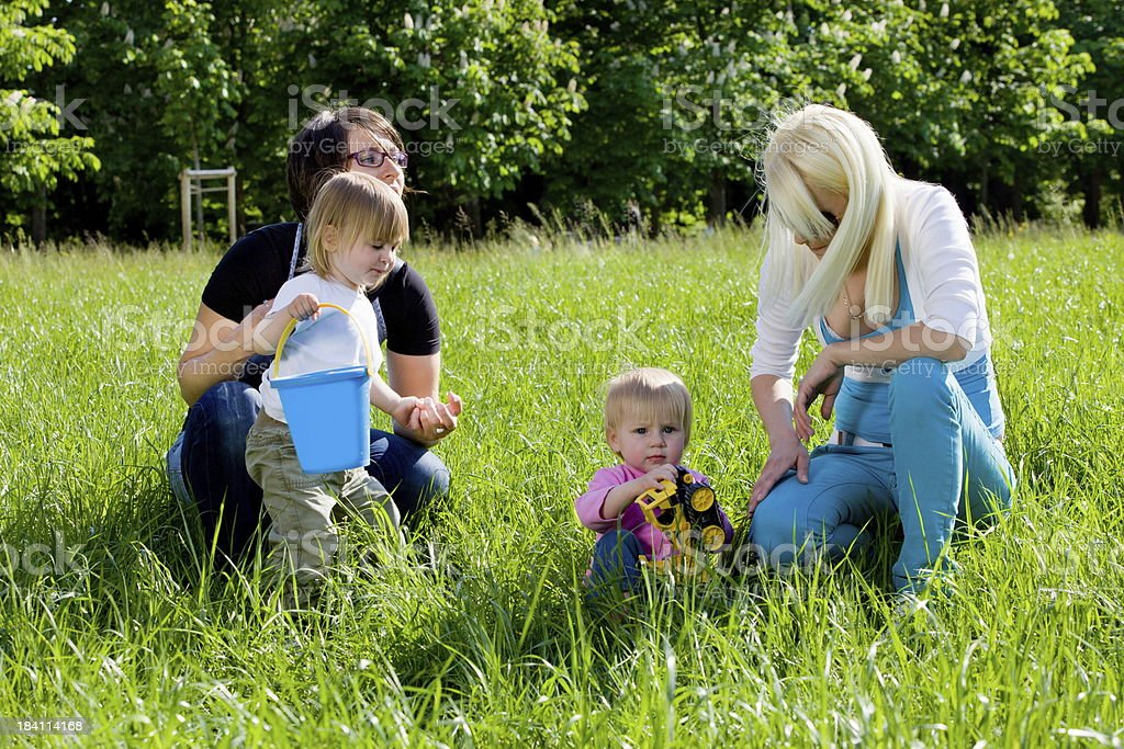 Young mothers in park playing with their babies royalty-free stock photo