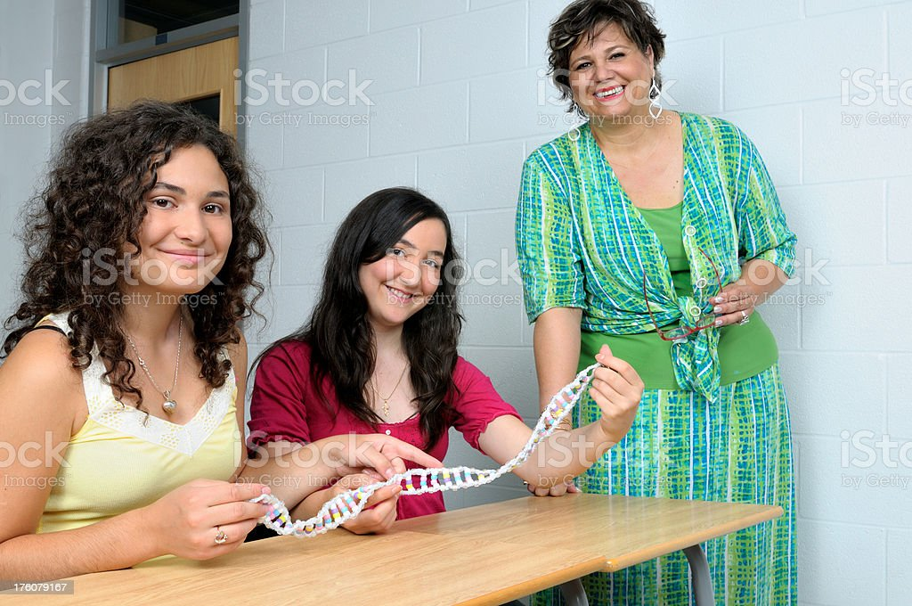 Young multi cultured students with science teacher royalty-free stock photo
