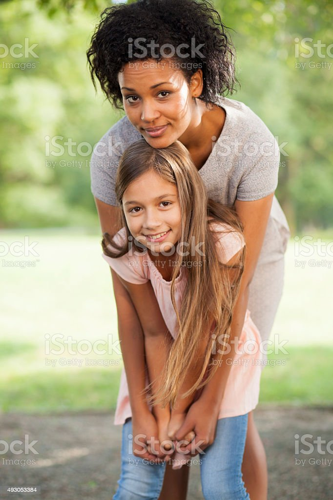 Young Multi Ethnic Family Having Fun In Park together stock photo