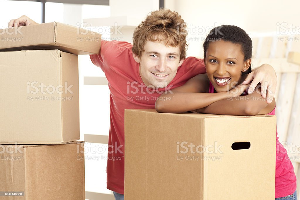 Young multiracial couple moving house royalty-free stock photo