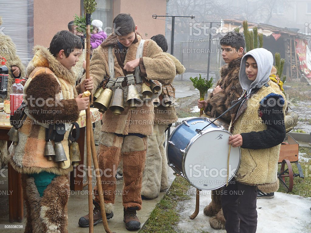 Young mummers play and dance in the old ritual Surva stock photo