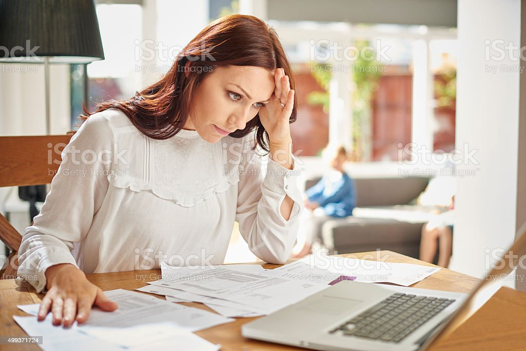 young mum's home finances stock photo