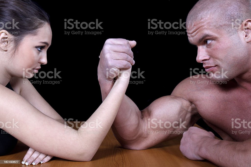 Young muscular couple fighting