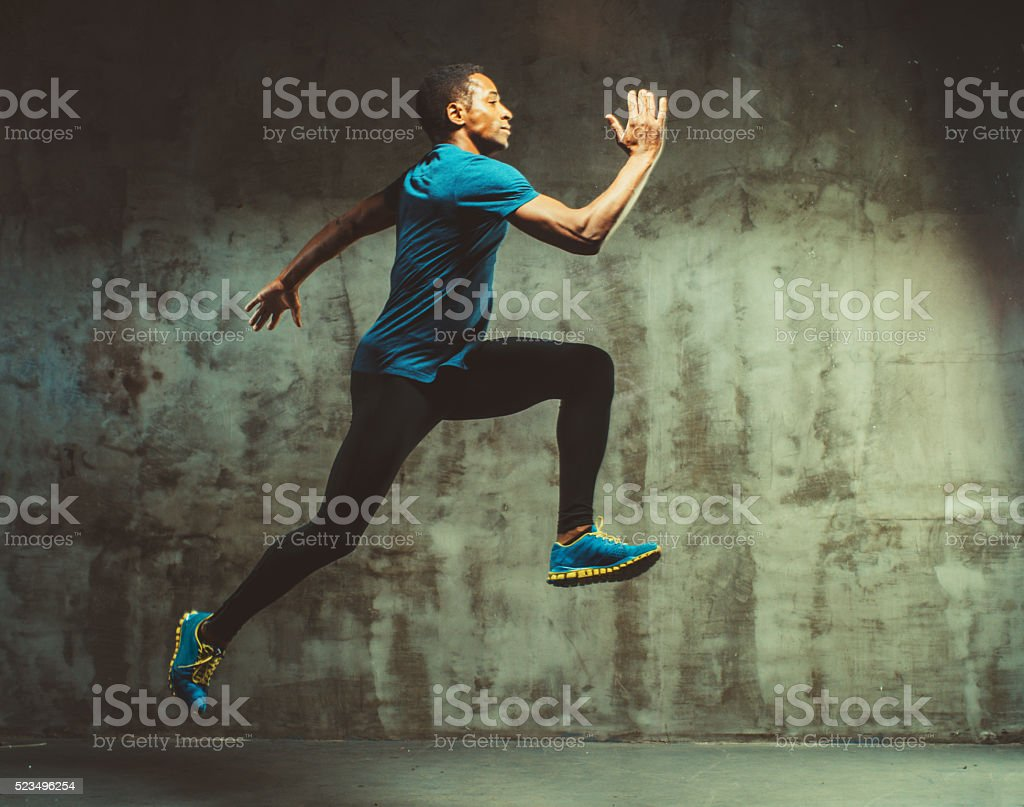 young muscular man doing cross training stock photo