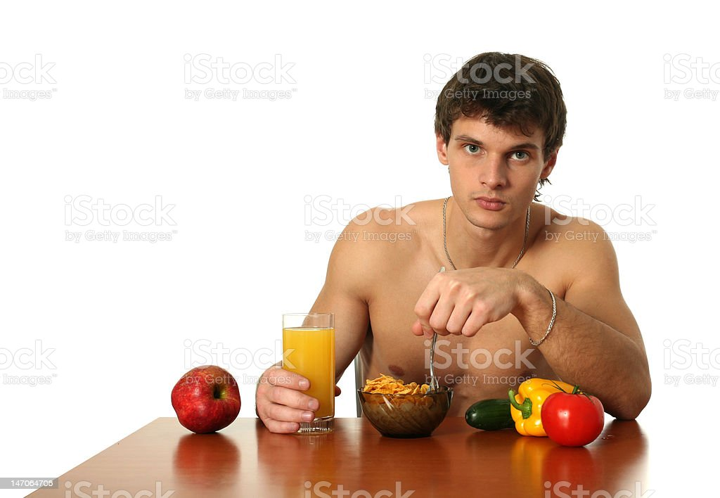 Young Muscular Man Eating His Breakfast royalty-free stock photo