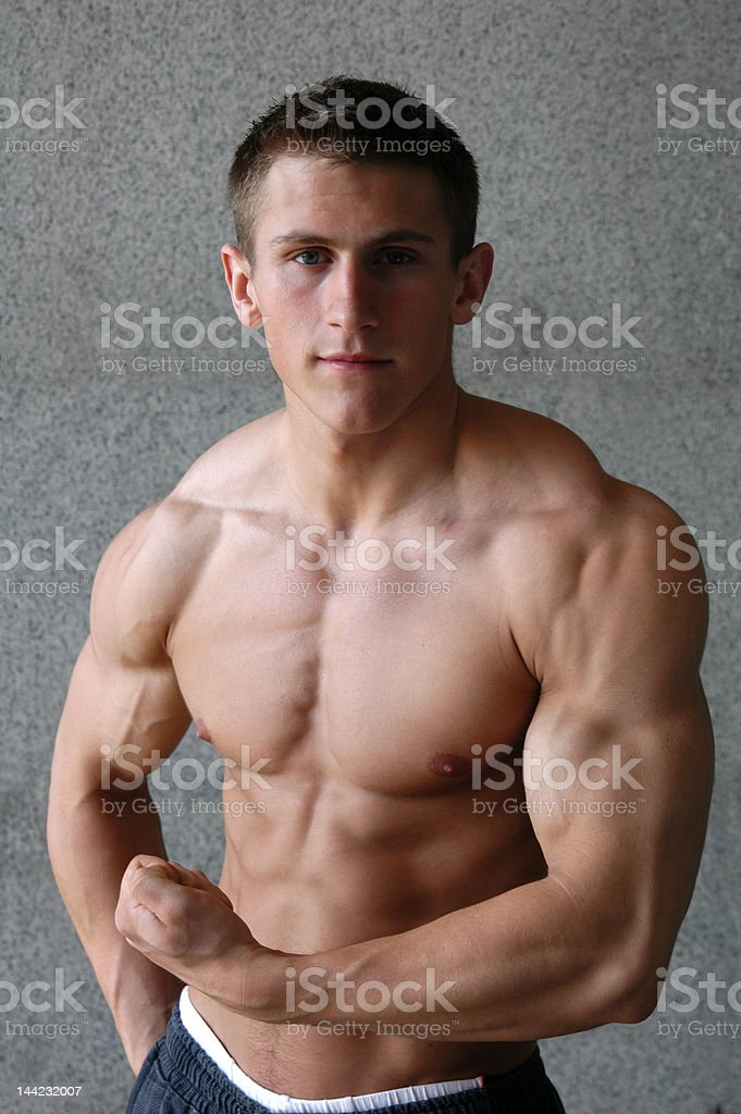 Young Muscular Man Flexing His Biceps royalty-free stock photo