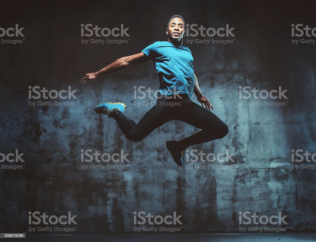 young muscular man jumping stock photo