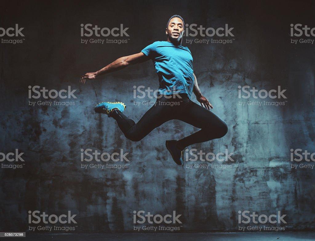 young muscular man jumping stock photo