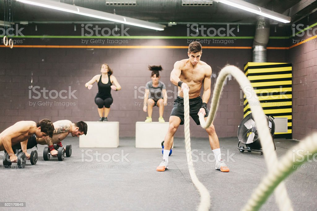 Young muscular man practicing endurance training. stock photo