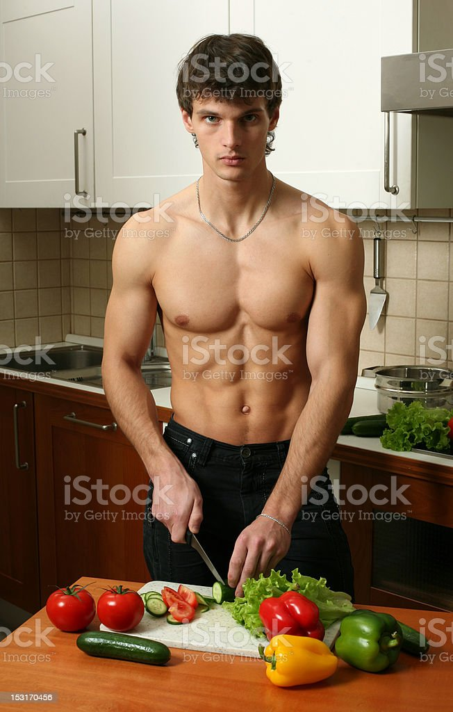 Young Muscular Man Preparing Salad royalty-free stock photo