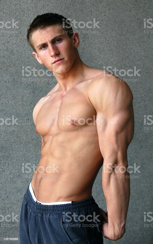 Young Muscular Man Showing His Muscles royalty-free stock photo