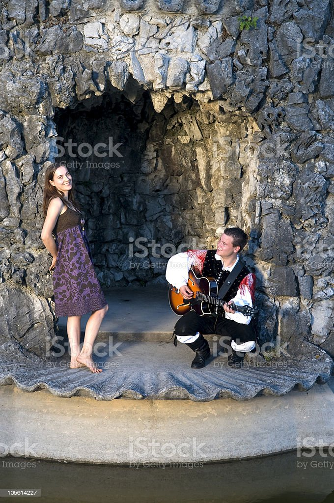 Young Musician Courting Pretty Woman royalty-free stock photo