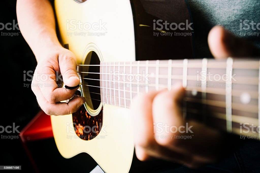 Young Musician Playing An Electric Guitar stock photo