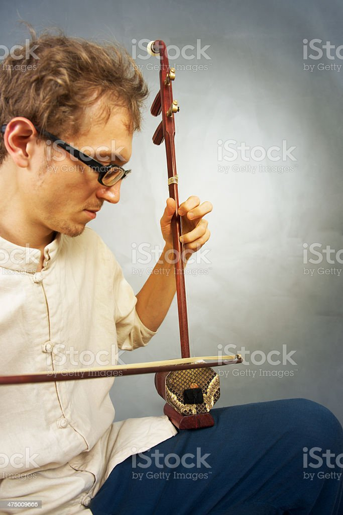 Young musician playing in erhu. stock photo
