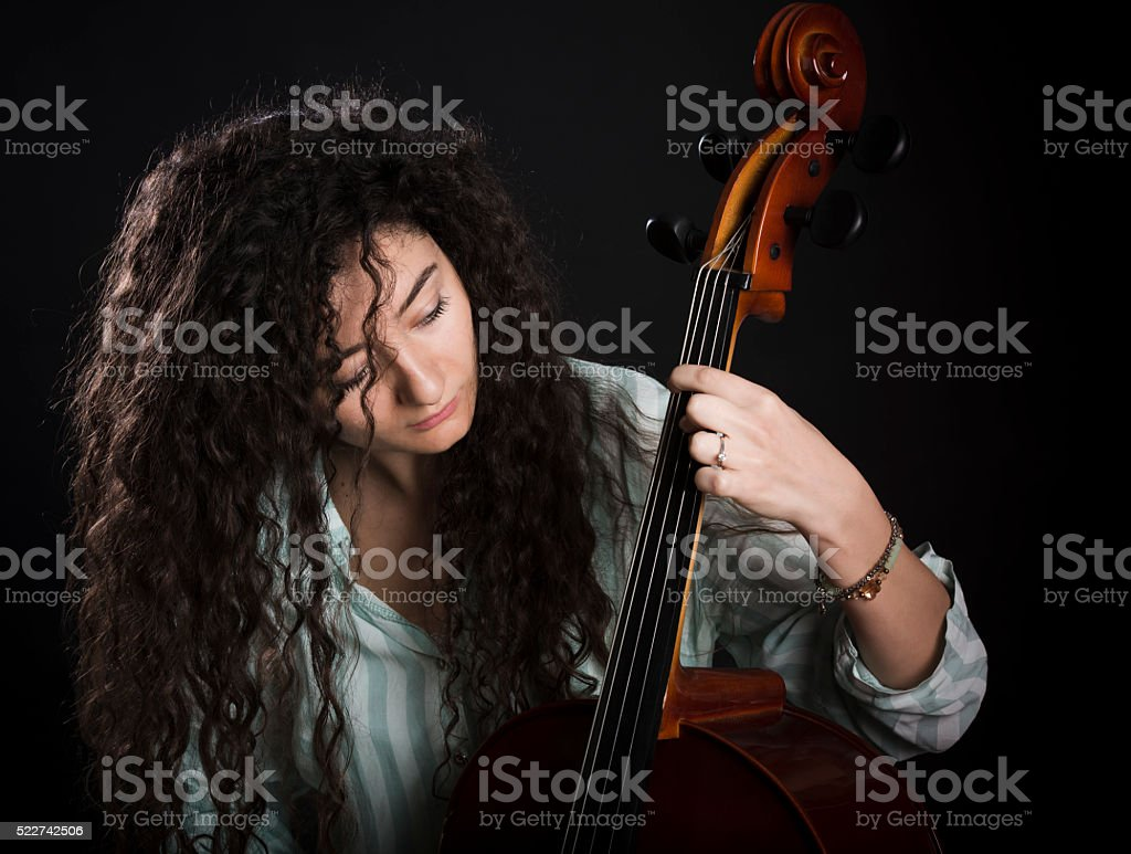 young musician plays the cello stock photo