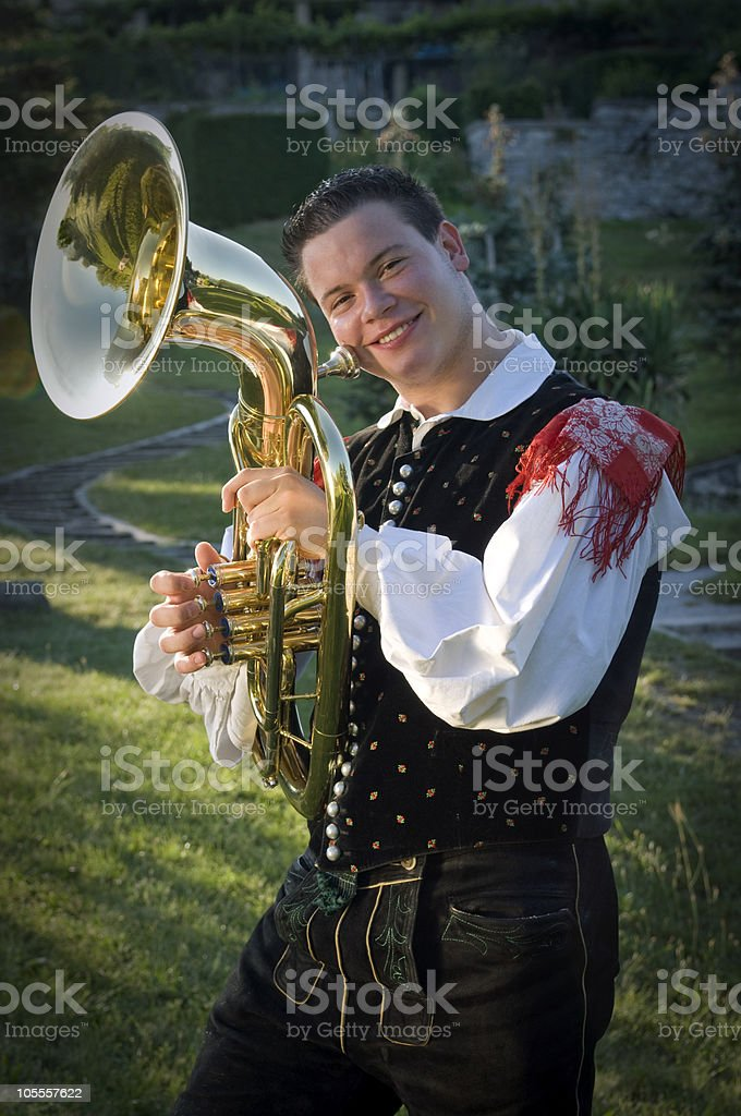 Young musician smiling with his saxophone stock photo