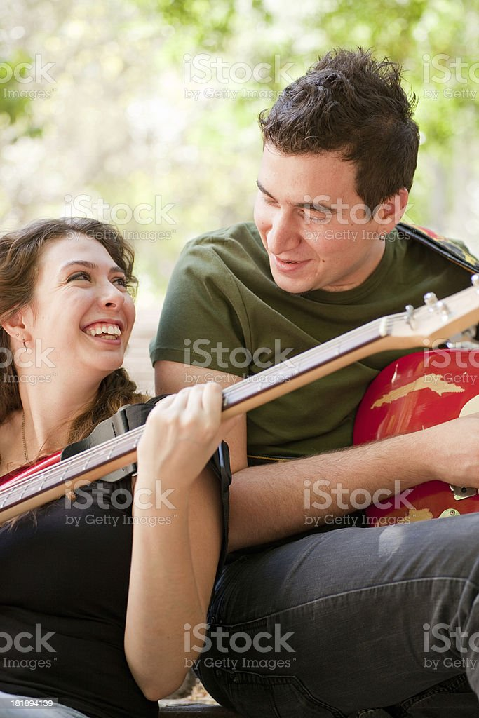 Young Musicians playing guitar in the park royalty-free stock photo