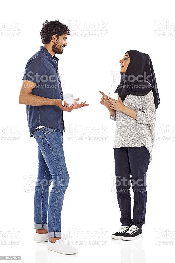 Young muslim couple having friendly chat royalty-free stock photo