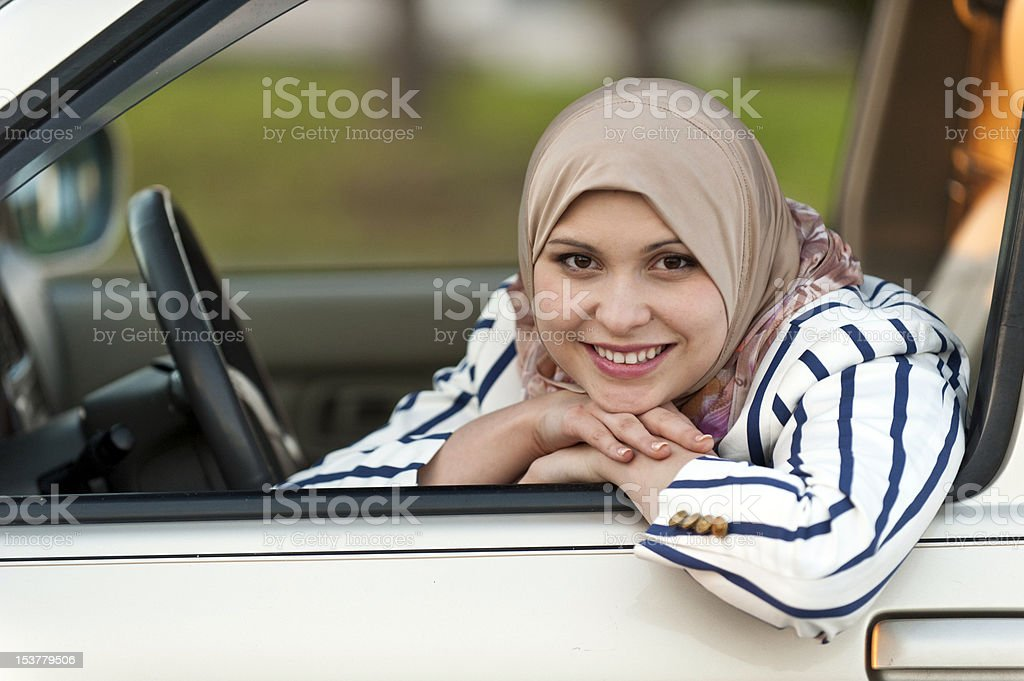 Young muslim female driver stock photo