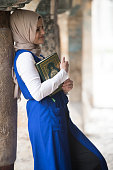 Young Muslim Girl Reading The Koran