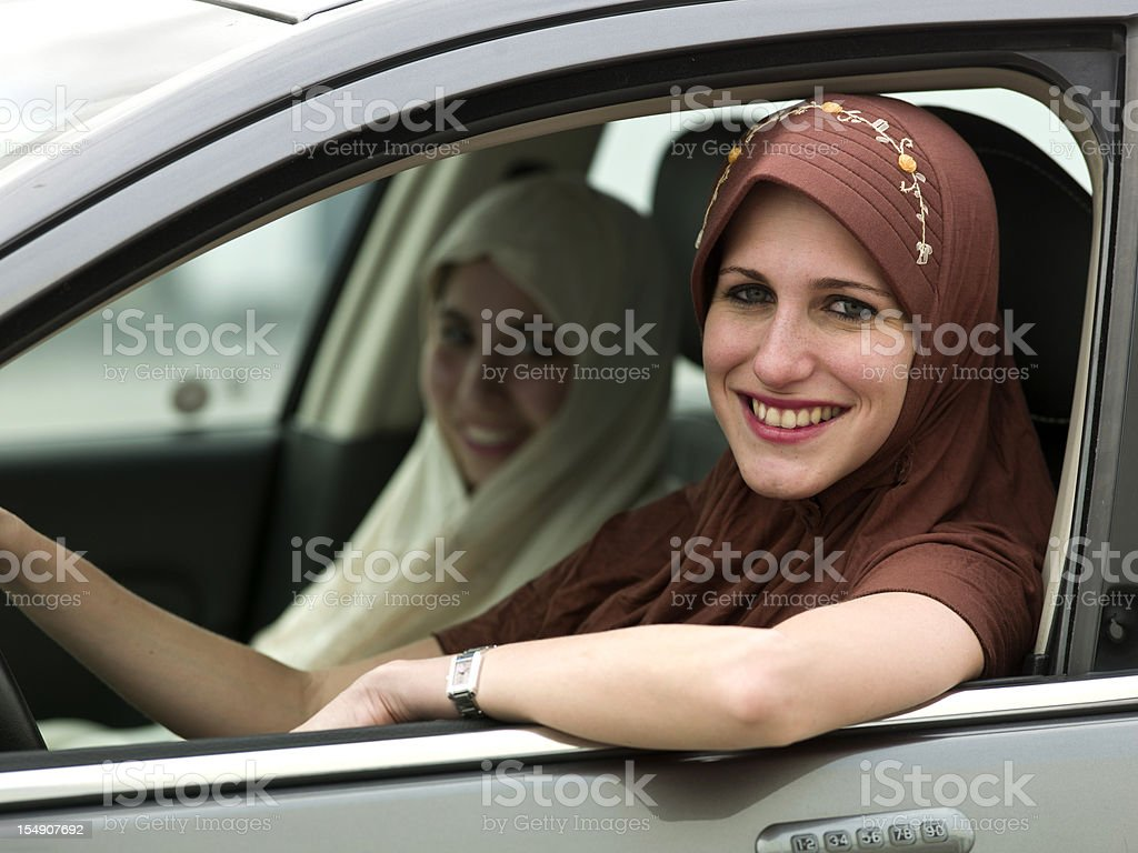 Young muslim girls in a car royalty-free stock photo