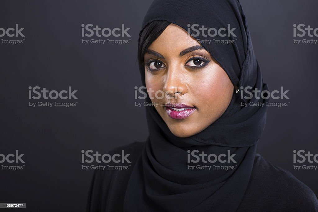 young muslim woman head shot stock photo