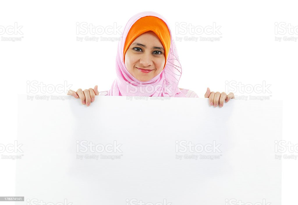 Young Muslim woman holding a white board stock photo