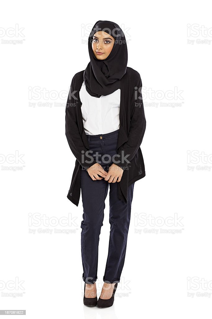 Young Muslim woman in a head scarf standing over white stock photo