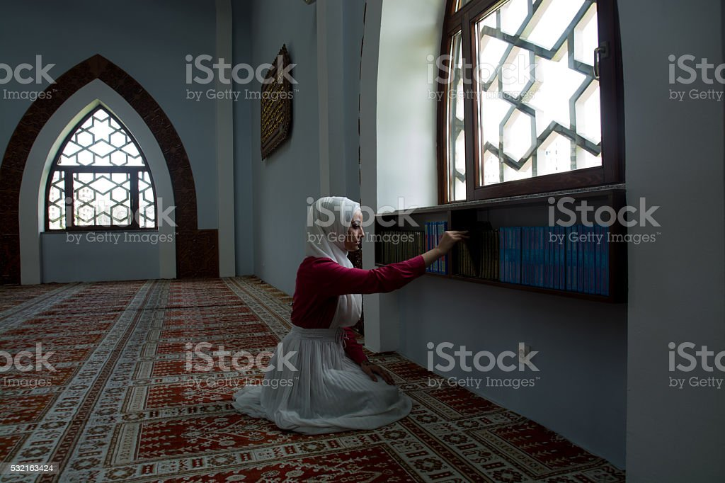 Young muslim woman in mosque stock photo