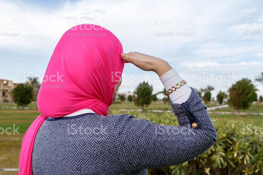 Young Muslim woman look far away. stock photo
