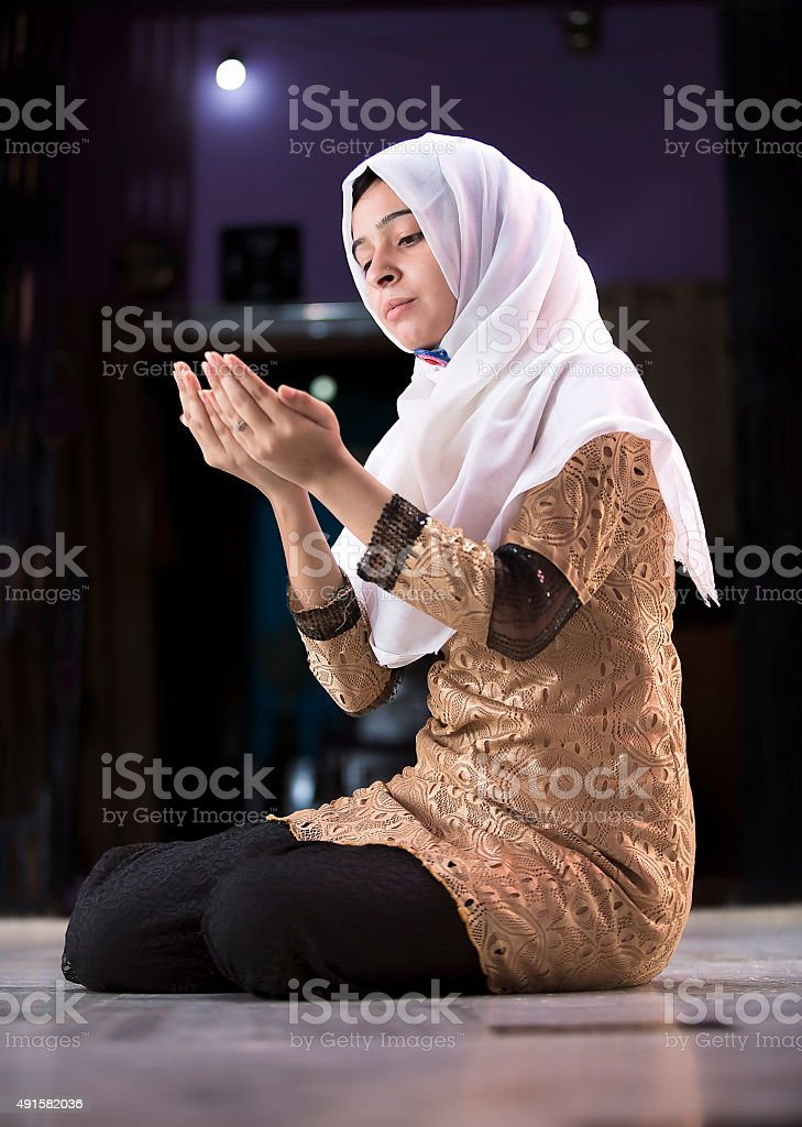 Young Muslim woman Praying stock photo
