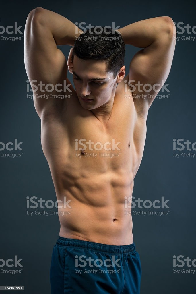Young musular man over grey background royalty-free stock photo