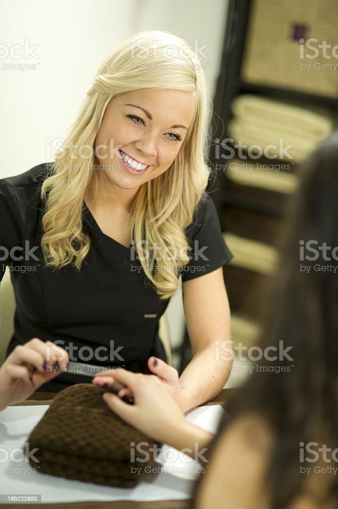 young nail technician stock photo