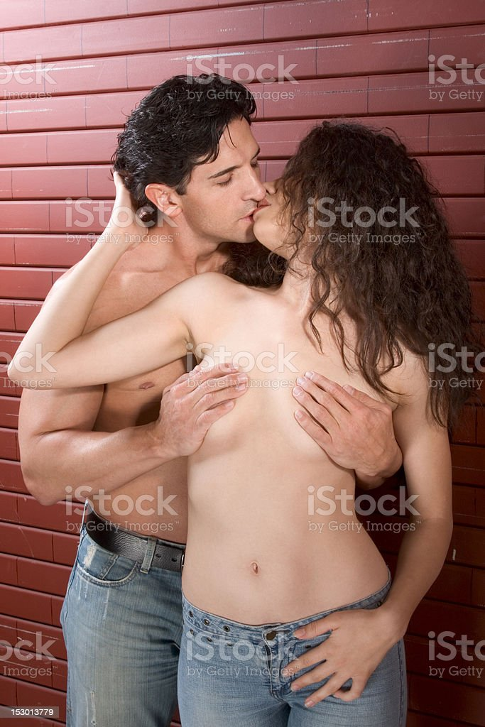 Young naked Man and woman in love are kissing royalty-free stock photo