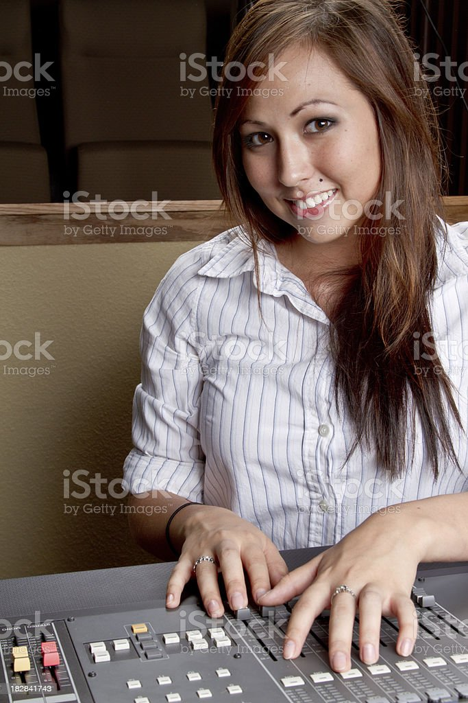 Young Native American Woman at a Recording Console royalty-free stock photo