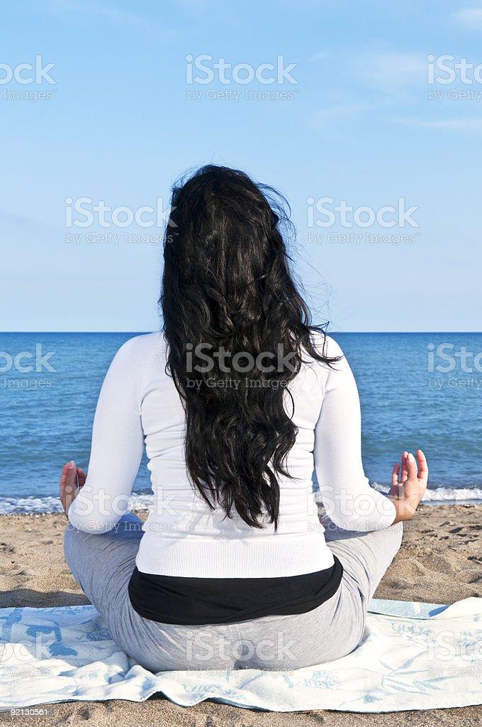 Young native american woman meditating royalty-free stock photo