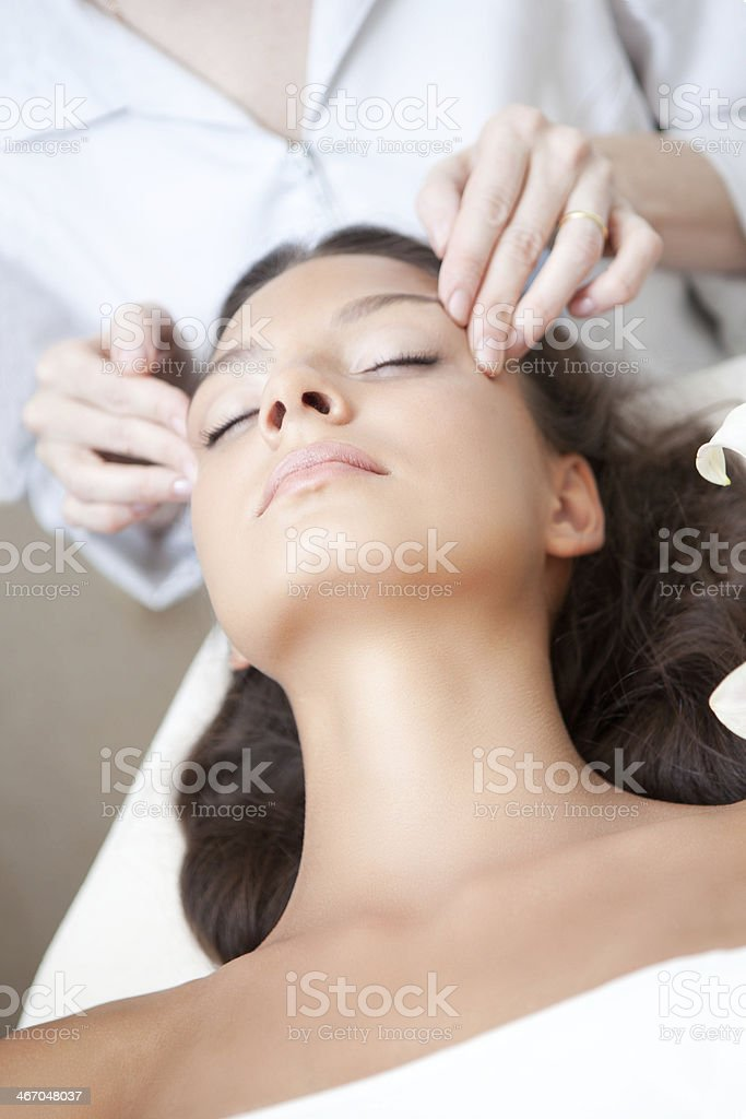 Young Natural Relaxing Beauty Having Moistening Mask Applied. royalty-free stock photo