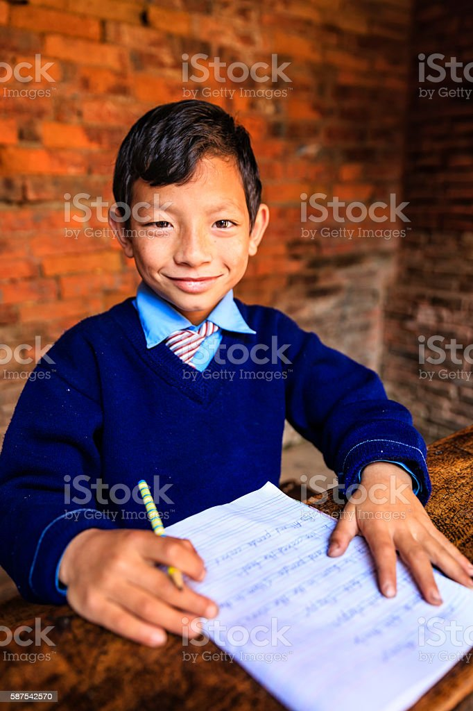 Young Nepali boy in classroom stock photo