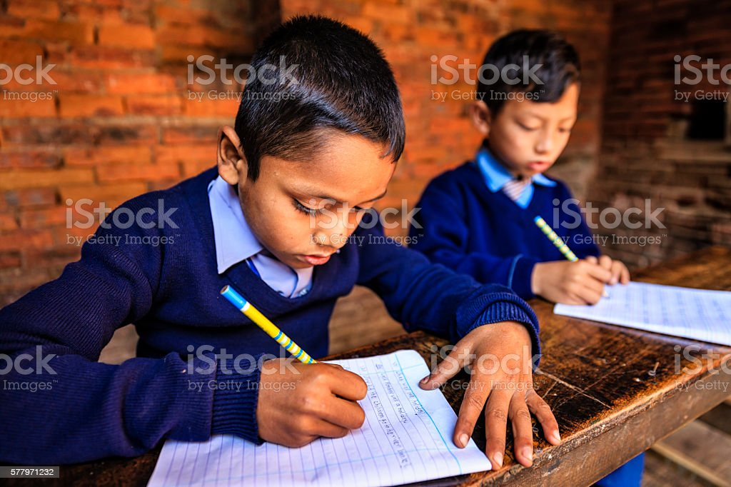 Young Nepali boys in classroom, Bhaktapur stock photo