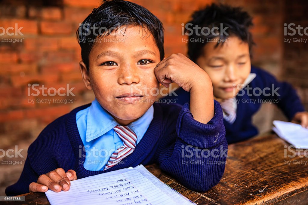 Young Nepali boys in classroom stock photo
