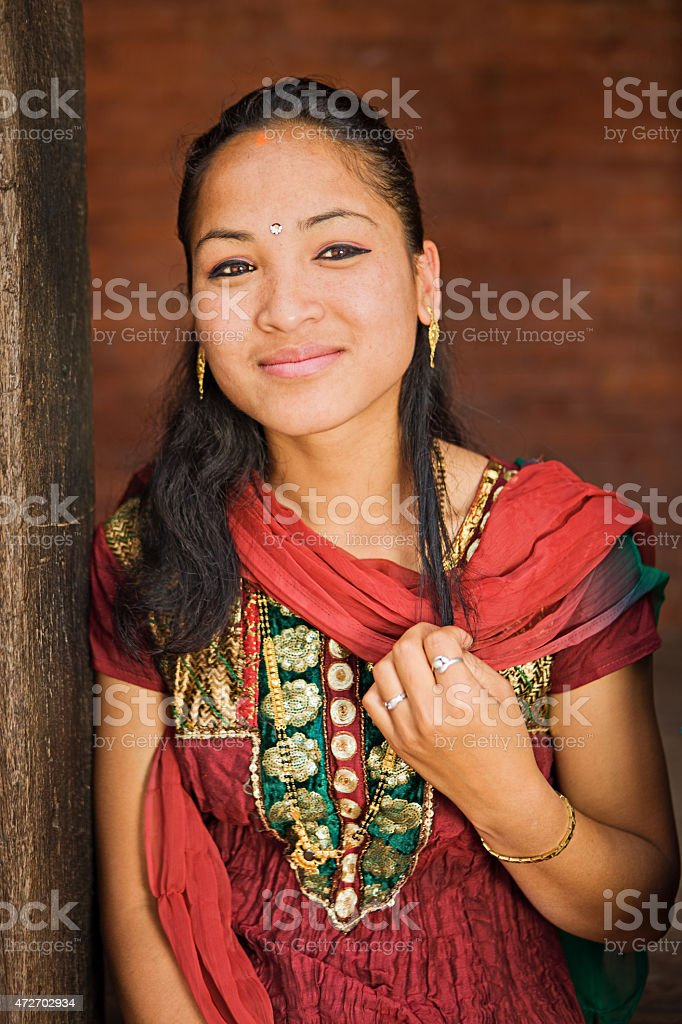 Young Nepali girl resting in Bhaktapur. stock photo