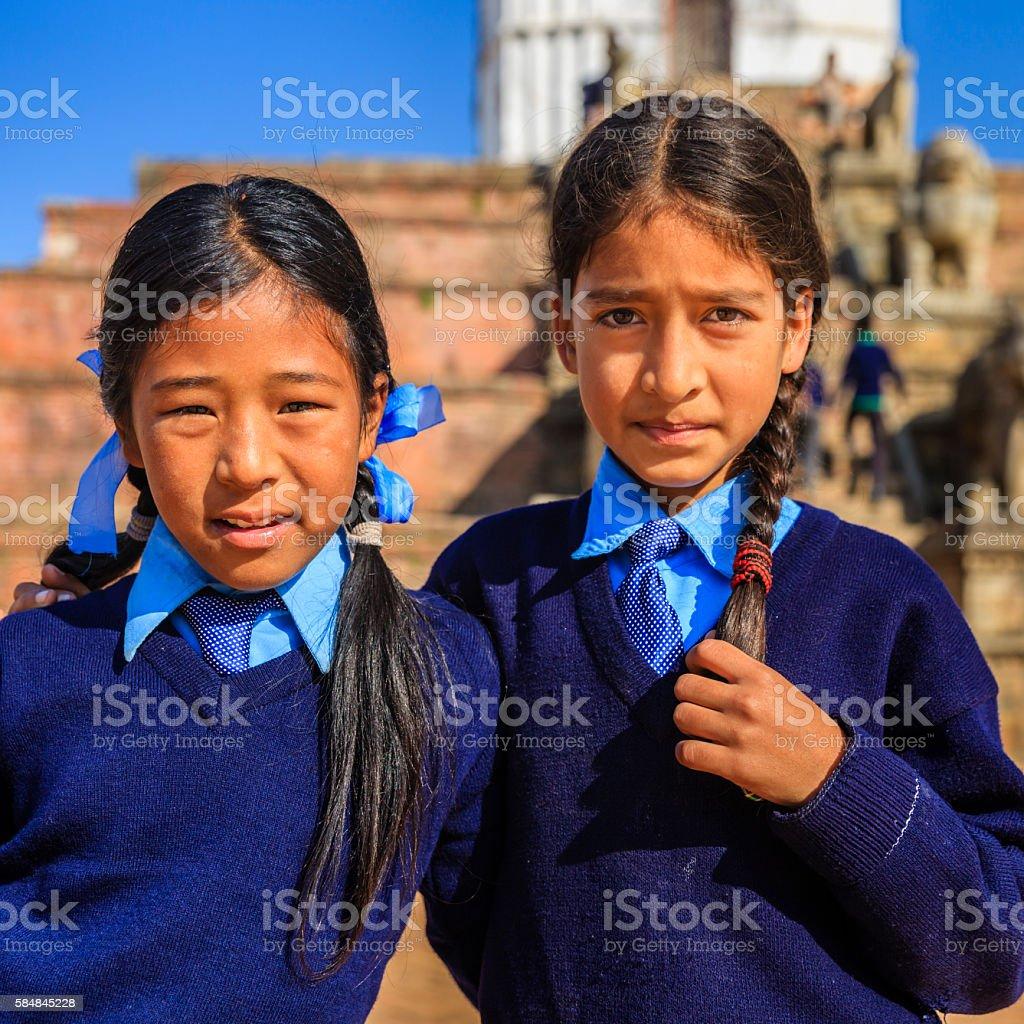 Young Nepali schoolgirls on Durbar Square in Bhaktapur, Nepal stock photo