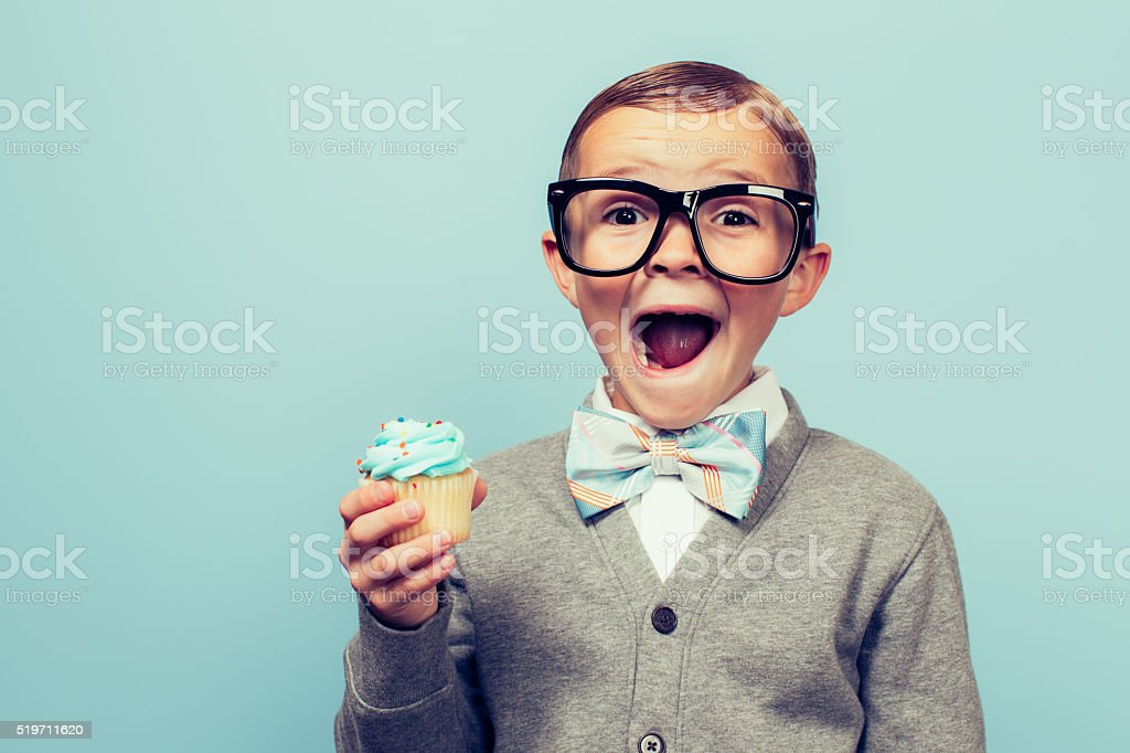 Young Nerd Boy Loves Dessert stock photo
