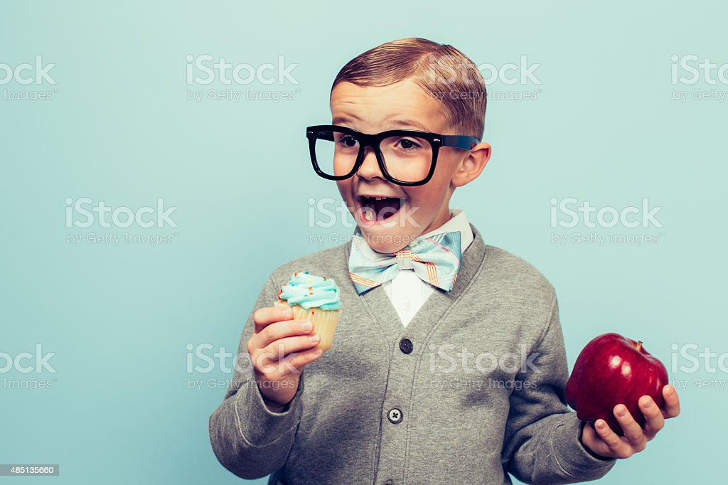 Young Nerd Boy Loves Unhealthy Food Choices stock photo