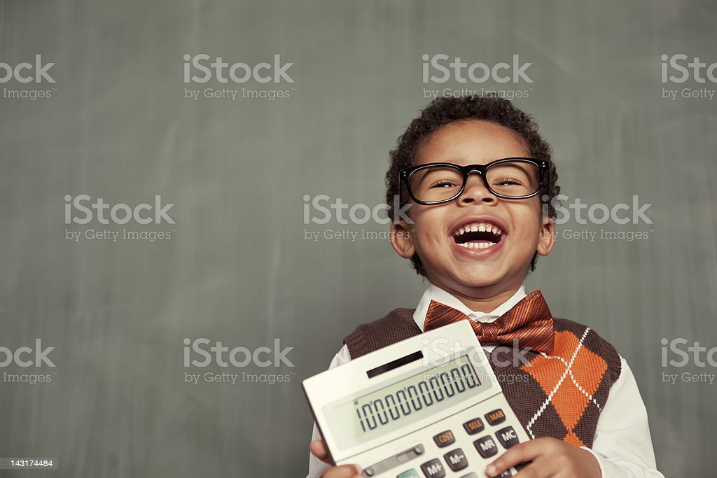 Young Nerd Boy Wearing Glasses Holding Calculator stock photo